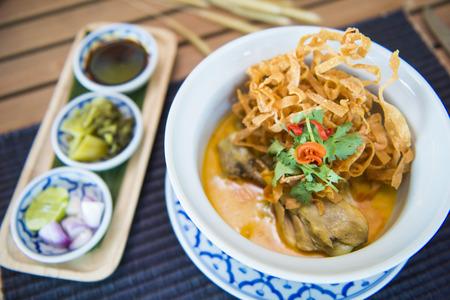 soi: curried noodle soup (khao soi), northern Thai cuisine