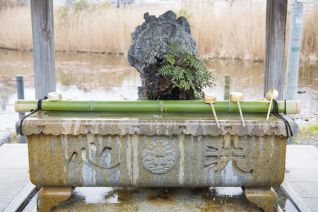 purify: Temizuya :: water ablution pavilion for a purify the soul in Japanese Shrine Stock Photo