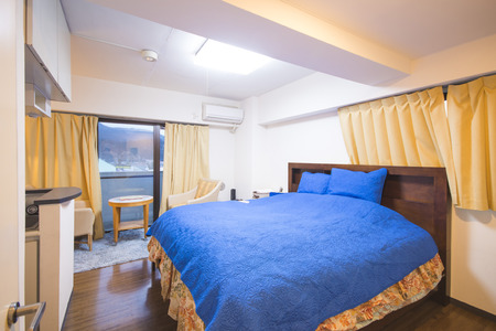 bed linen: interior of bedroom with blue bed linen, comfortable Editorial