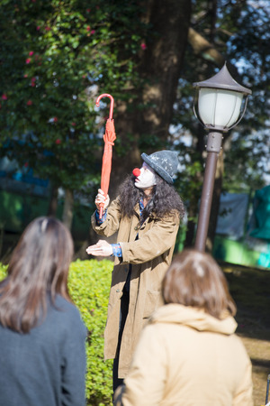 inventive: UENO, JAPAN - FEBRUARY 19, 2016 : magic show at Ueno park, the show open with a hat Editorial