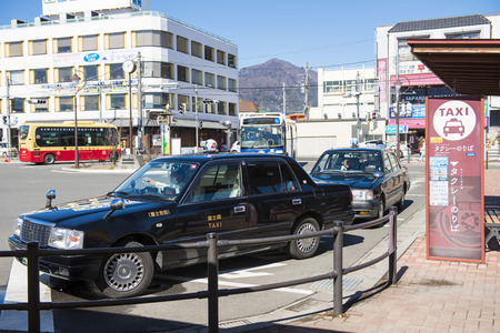 parking station: Kawaguchiko Japan , 20 February 2016 :: Taxi parking in Kawaguchiko train station , car Editorial