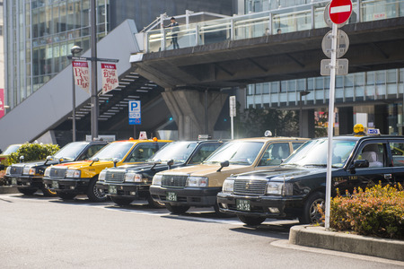 waiting passengers: Tokyo, Japan - February 20, 2016 : parking area of taxis for waiting passengers, transportation