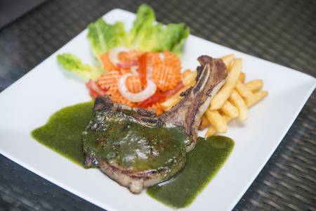 kos: pork steak with black pepper sauce, food Stock Photo