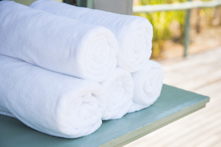 white towel: rolled up white towel, soft