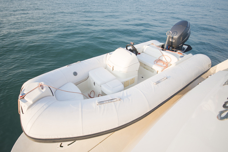 inflatable boat: inflatable boat on the sea, transport