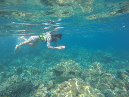 surin: girl is snorkeling in Surin Island, Phang-nga, travel Editorial