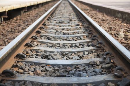 railway transportation: old railroad tracks at railway station, transportation