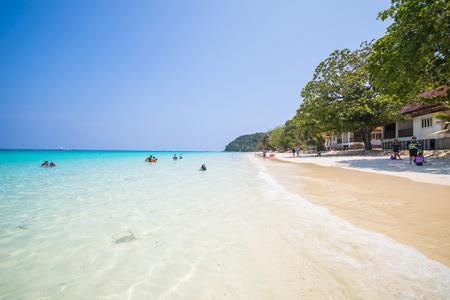 ton: Mai Ton Island, Thailand - April 11, 2016 : Tourists are enjoying on tropical beach with blue sky, summer