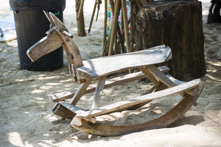 rocking: wooden rocking horses for seat on sand Stock Photo