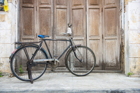 front house: Old bicycle in front of an ancient house, bike