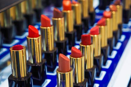 multi colorful: Beautiful multi colorful lipsticks on cosmetics counter, makeup Stock Photo