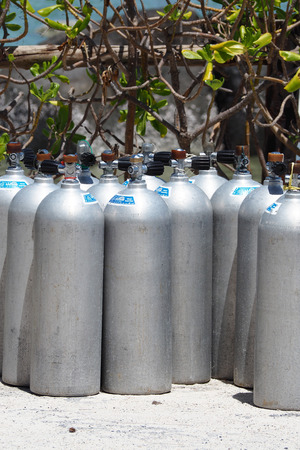 compressed air: Metal scuba diving oxygen tanks, equipment