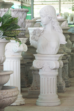 figurines: Stucco figurines for decoration in the garden, roman style Stock Photo