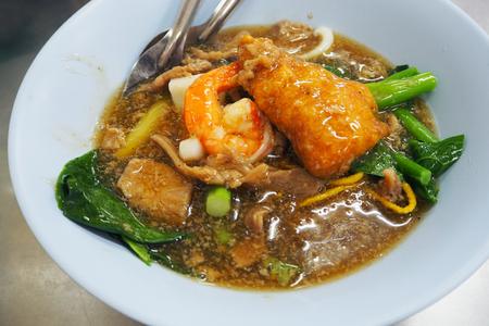 rad: Rad Na or stirred fried noodle with pork and shrimp, thai style food