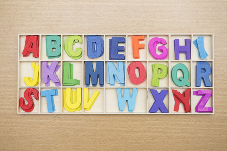 english letters: Colorful wooden english letters in box, education