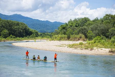 downstream: Phang-nga, Thailand - July 31, 2016: Bamboo Rafting at Glacier Emerald Kuraburi district, Phang-nga, Thailand Editorial
