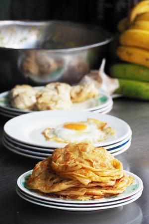 paratha: traditional roti paratha fried pancake, Indian food