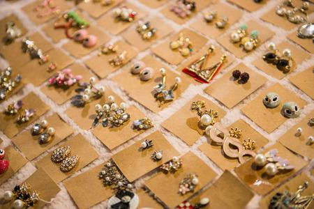 Ladies earrings for sale on market, beautiful Standard-Bild