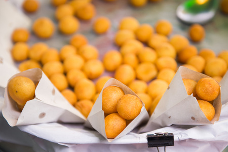 asian flavors: thai fried sweet potato balls for sale in market   Stock Photo