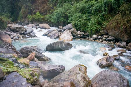 stream in Nepal : water from Annapurna mountain range , waterfall Stock Photo