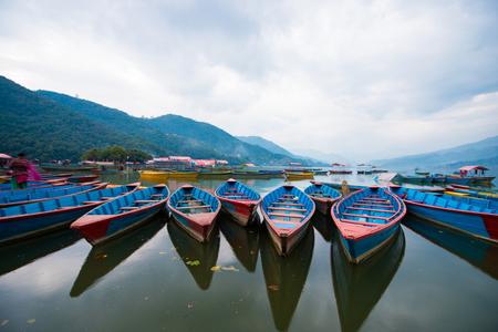 phewa: rowboat symbol of Phewa lakeshore in Pokhara city , Nepal