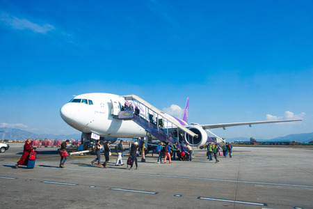 Nepal - 4 January 2017 :: plane of Thai Airways at Kathmandu airport , vehicle Editorial