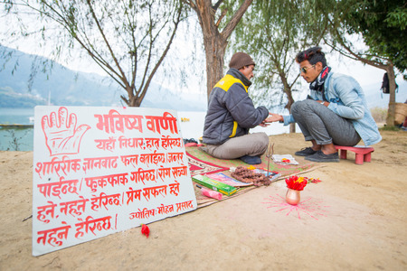 Nepal - 23 December 2017 :: prophet see fingerprint and foretell to Nepalese man, believe