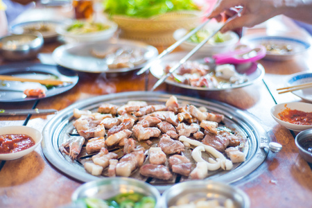Grilled pork barbecue korean style in restaurant , cook