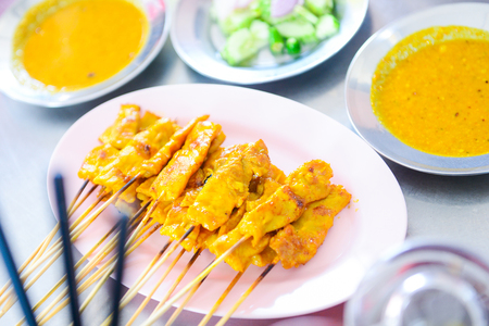 peanut sauce: delicious pork satay served with peanut sauce and vegetable, meat Stock Photo