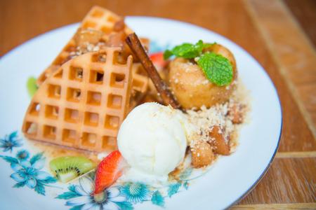 waffle with vanilla ice cream and apple, dessert