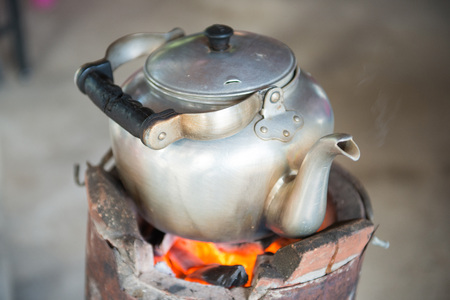 The old kettle on a charcoal stove, pot