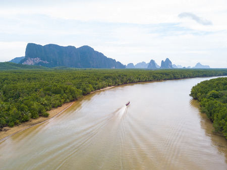 Aerial view of long tail boat moving on canal in the mangrove forest, Phang nga Bay, Phang-nga, Thailand Stock Photo