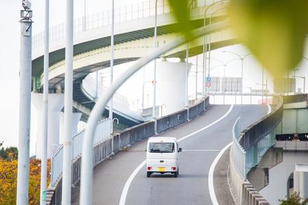Osaka, Japan - November 13, 2017 :Elevated express way, double exposure Фото со стока - 120751758