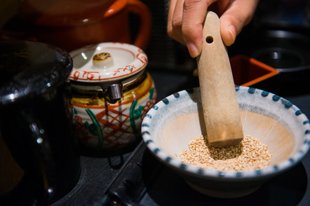 Sesame in a bowl with mini grinder for Japanese Tonkatsu pork, seed