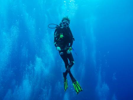 Female scuba diver, water sport
