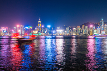 Hong Kong - January 10, 2018 :Chinese wooden sailing ship with red sails in Victoria harbor at Hong Kong Island, landmark