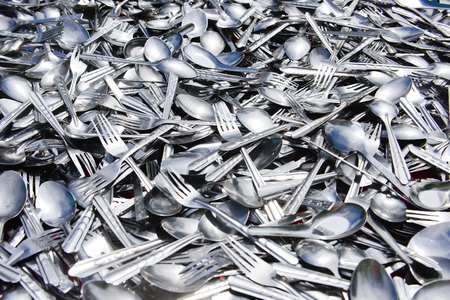 Pile of various stainless spoons and forks on table in outside Stock fotó - 101194719