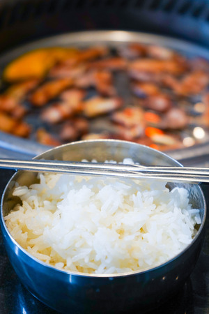 cooked rice in stainless steel bowl, rice
