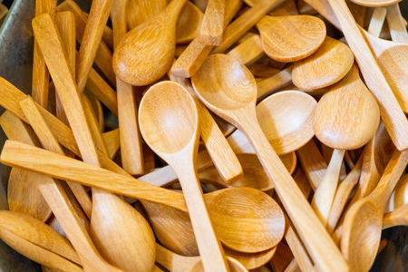 Pile of wooden spoon for sale in store, kitchenware
