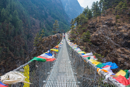 suspension bridge for cross the river on mountain, Nepal