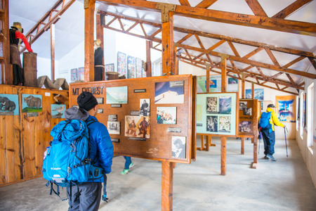 9 April 2018 - Nepal ::traveller is reading information at Sherpa Museum, Namche Bazaar