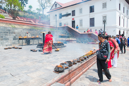 23 April 2018 - Nepal ::Hindu people burn candle for pray at Pashupatinath temple , Nepal Stock Photo - 120752426
