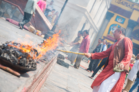 23 April 2018 - Nepal ::Hindu people burn candle for pray at Pashupatinath temple , Nepal Stock Photo - 120752427