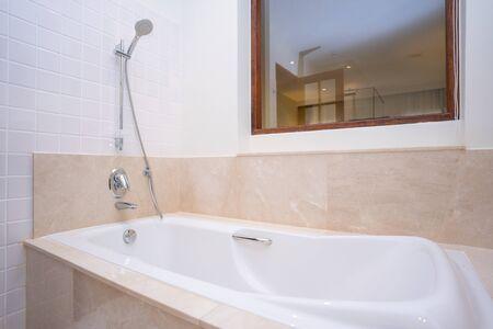 big white bathtub in shower room,bath Foto de archivo - 126635902