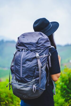 woman backpacker travel on mountain,backpack