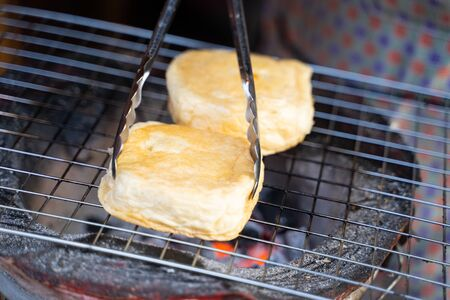 toast grilled bread with butter,toast Imagens