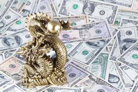 Gold dragon, symbol of year against dollars. Momey photo