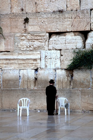 Prayer at the wailing wall, Jerusalem, Israel photo
