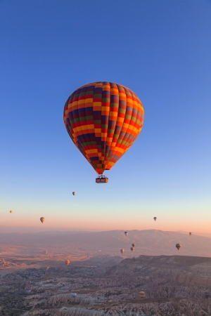 Balloons in the sky over Cappadocia at sunrise photo