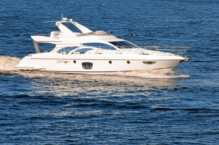 Luxury motor yacht under way out at sea